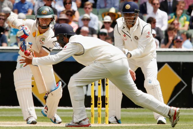 Rediff Sports - Cricket, Indian hockey, Tennis, Football, Chess, Golf - Dhoni first Indian 'keeper to take 50 catches vs Australia in Tests
