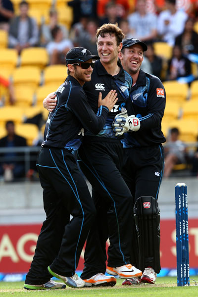 Team New Zealand celebrates the fall of an Indian wicket