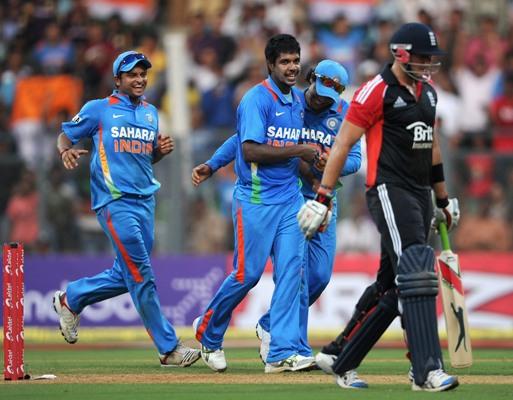 Varun Aaron celebrates a wicket.