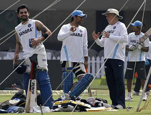 (From left) Virat Kohli, MS Dhoni and coach Duncan Fletcher