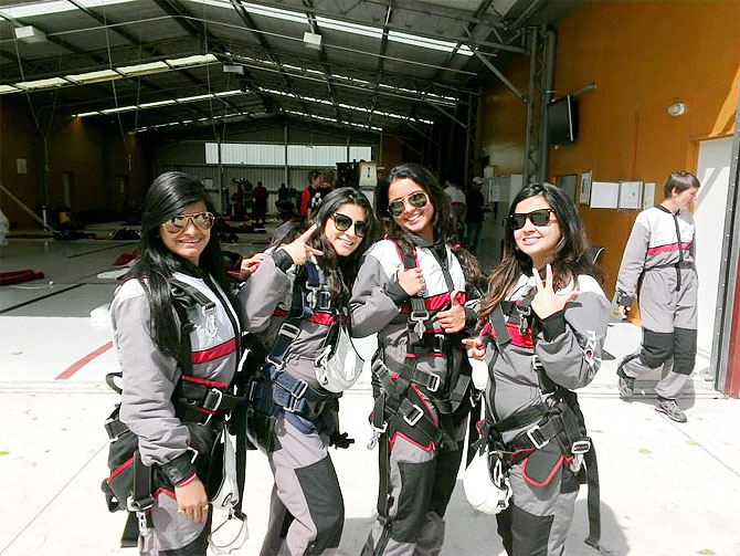 Sakshi Dhoni (right), Puja Pujara, Preethi Lakshminarayanan before going skydive