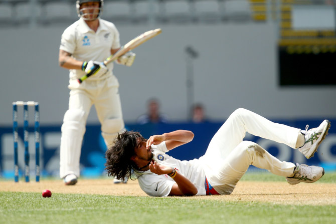 Ishant Sharma fields the ball on his follow through