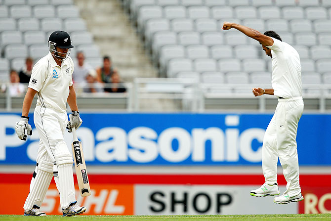 Peter Fulton of New Zealand (left) walks off after being dismissed LBW by Zaheer Khan