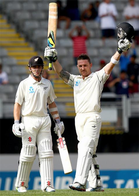 Brendon McCullum of New Zealand celebrates his century as Kane Williamson looks on