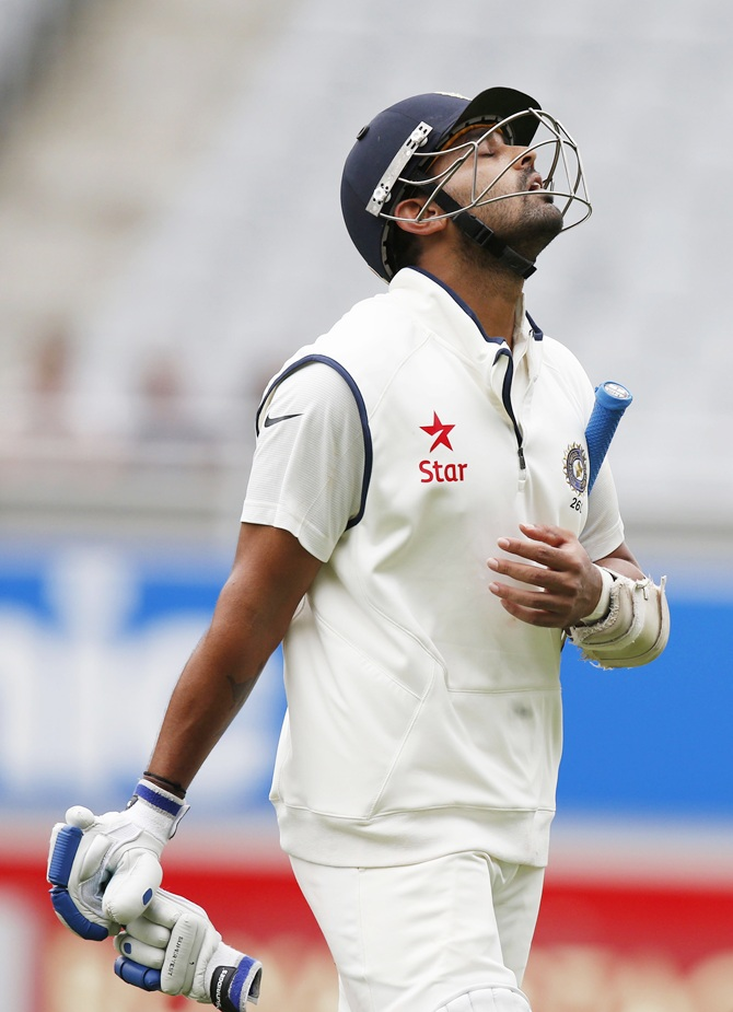India's Murali Vijay reacts after being bowled out