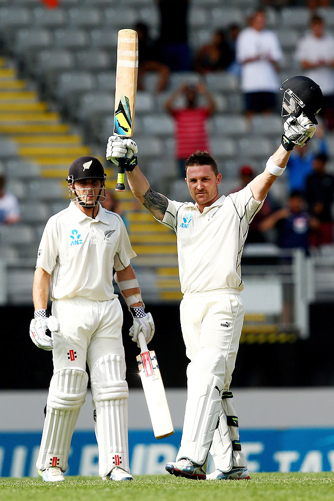 Brendon McCullum of New Zealand celebrates his century in Auckland