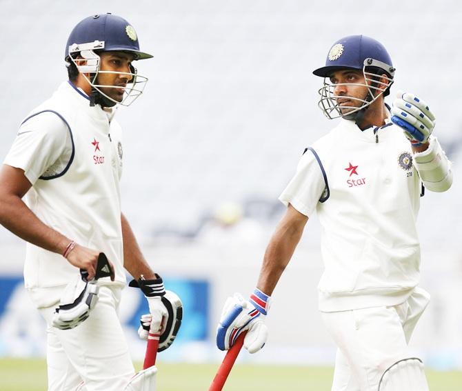 India's Ajinkya Rahane, right and Rohit Sharma.