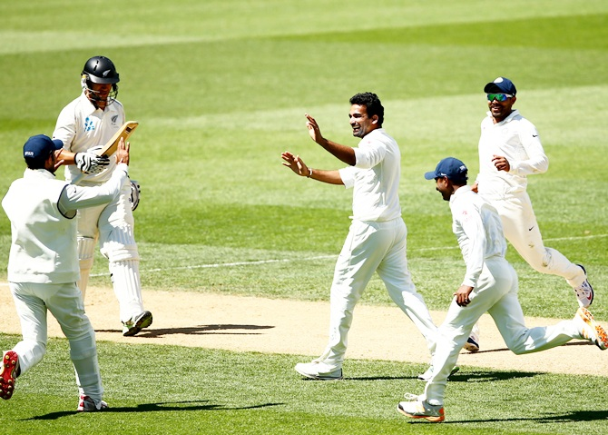 Zaheer Khan of India,centre, celebrates the dismissal of Ross Taylor