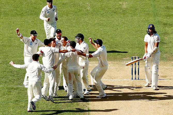 New Zealand celebrate the final wicket of Ishant Sharma to win the 1st Test match at Eden Park in Auckland on Sunday