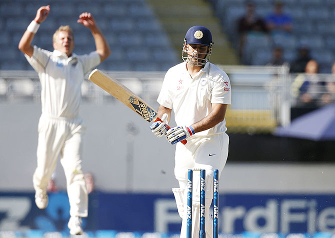 New Zealand's Neil Wagner (left) celebrates dismissing India's MS Dhoni on Sunday