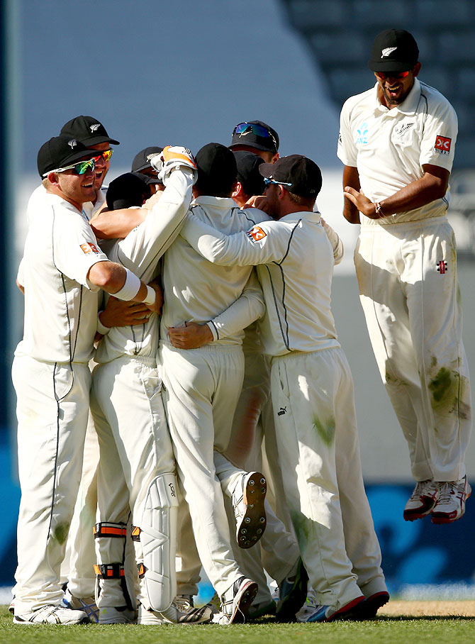 New Zealand celebrate the wicket of Ishant Sharma to win the first Test at Eden Park in Auckland on Sunday