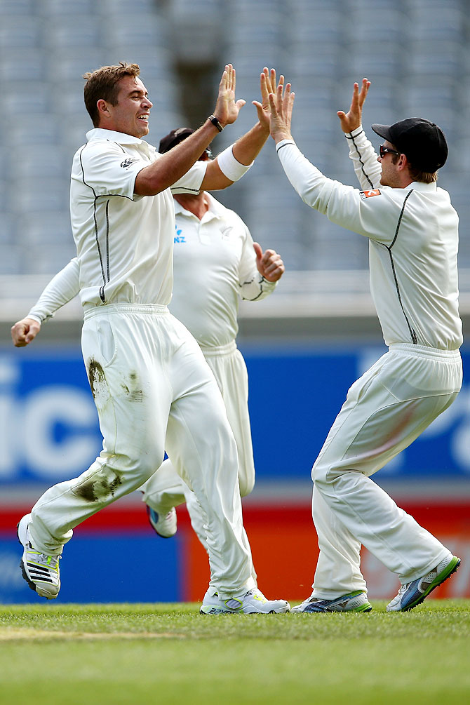 Tim Southee (left) celebrates the wicket of Cheteshwar Pujara