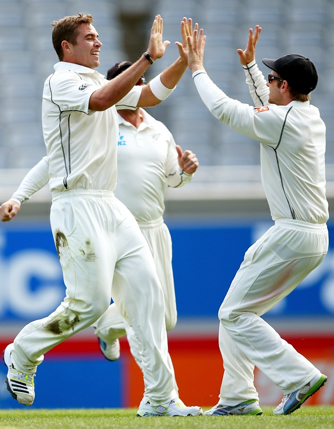 http://im.rediff.com/cricket/2014/feb/12kiwi1.jpg Tim Southee (left) celebrates a wicket