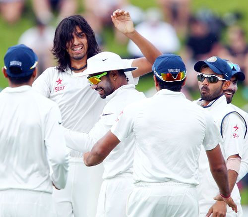 Ishant Sharma of India celebrates after taking the wicket of Peter Fulton of New Zealand