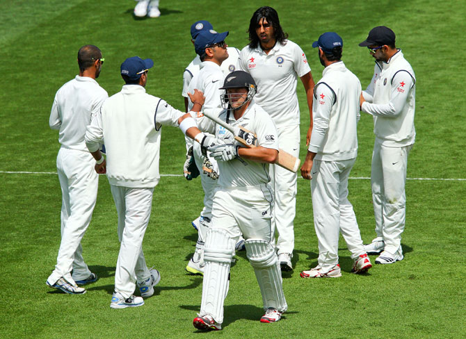Ishant Sharma is congratulated after taking the wicket of Corey Anderson