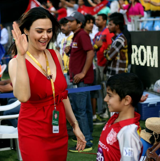 Preity Zinta, co-owner of Kings XI Punjab, with a young fan