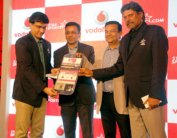 Former India cricket captains Sourav Ganguly and Kapil Dev at the Vodafone-Star India tie-up in Mumbai on Thursday