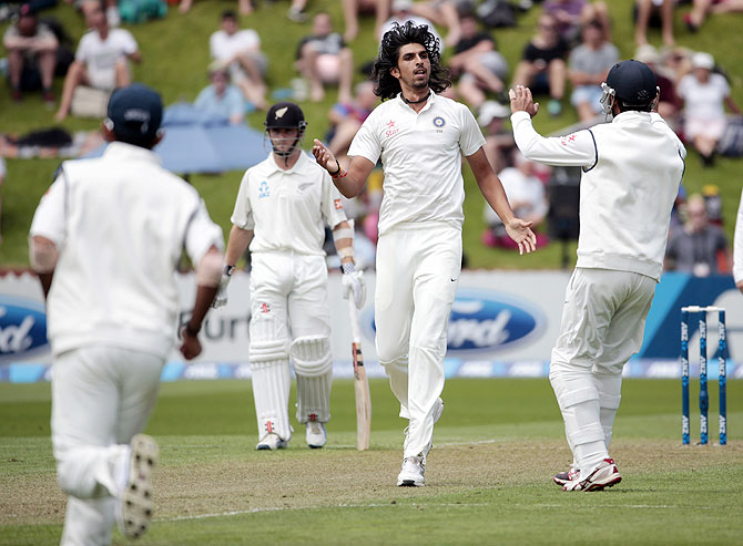 Ishant Sharma celebrates the dismissal of New Zealand's Tom Latham