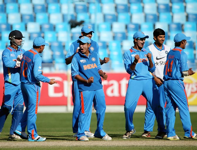The Indian players celebrate the wicket of Pakistan's Kamran Ghulam during the ICC Under-19 World Cup Group A match