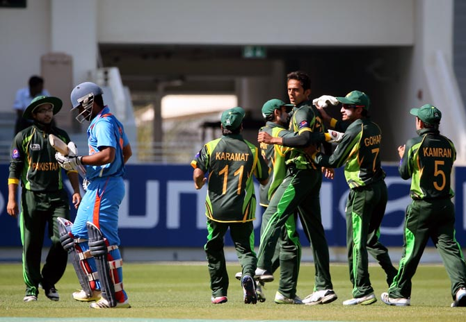 Pakistan's players celebrate a wicket