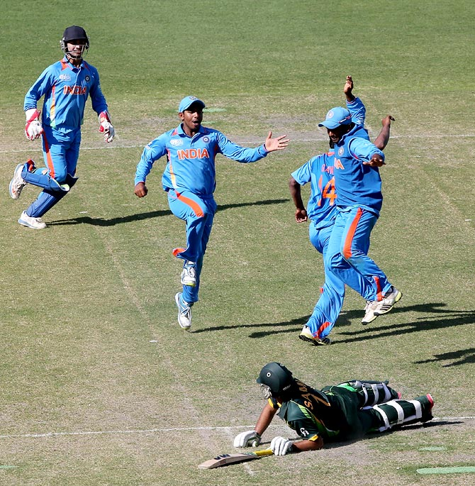 The Indian players celebrate the dismissal of Pakistan's Sami Aslam