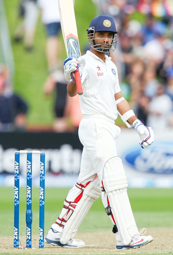 Ajinkya Rahane of India celebrates his half century.