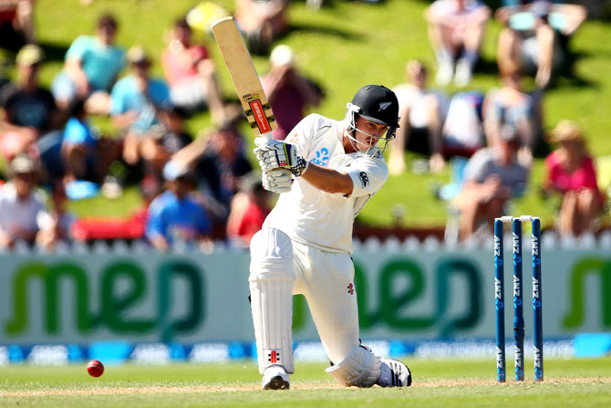 Hamish Rutherford of New Zealand bats during day three