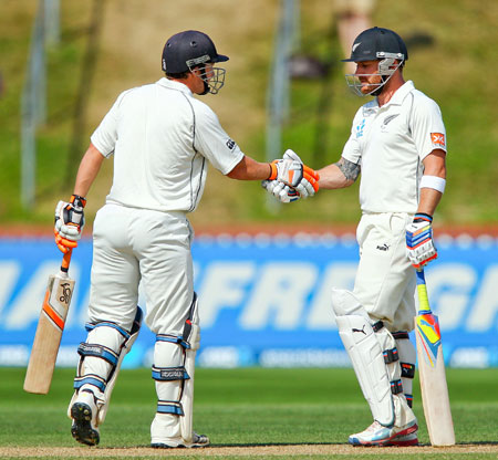 New Zealand's BJ Watling (left) and Brendon McCullum shake hands after breaking the world record for the sixth wicket partnership during Day 4