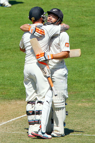 BJ Watling (right) celebrates his century with teammate Brendon McCullum