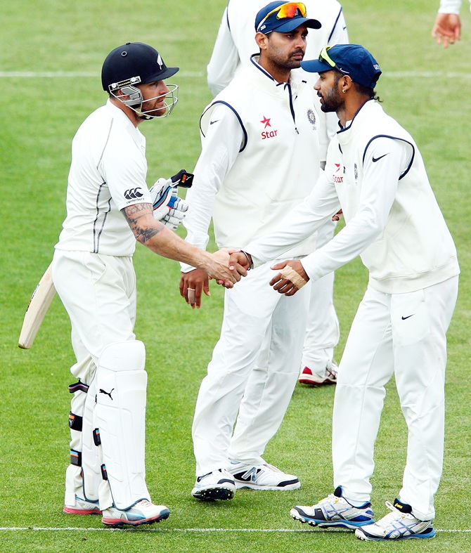 Brendon McCullum of New Zealand is congratulated by Shikar Dhawan of India after reaching 300 runs.