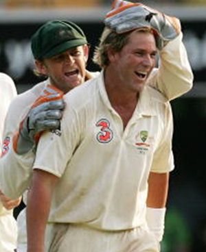 Adam Gilchrist and Shane Warne celebrate a dismissal during the first Ashes Test between Australia and England at The Gabba on November 26, 2006