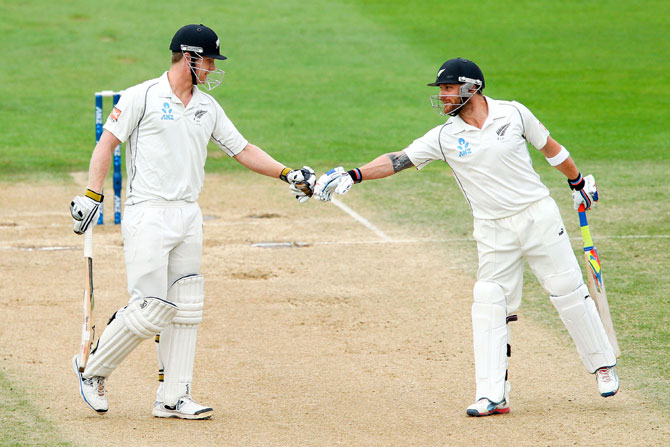 Brendon McCullum encourages teammate James Neesham in between balls during Day 5
