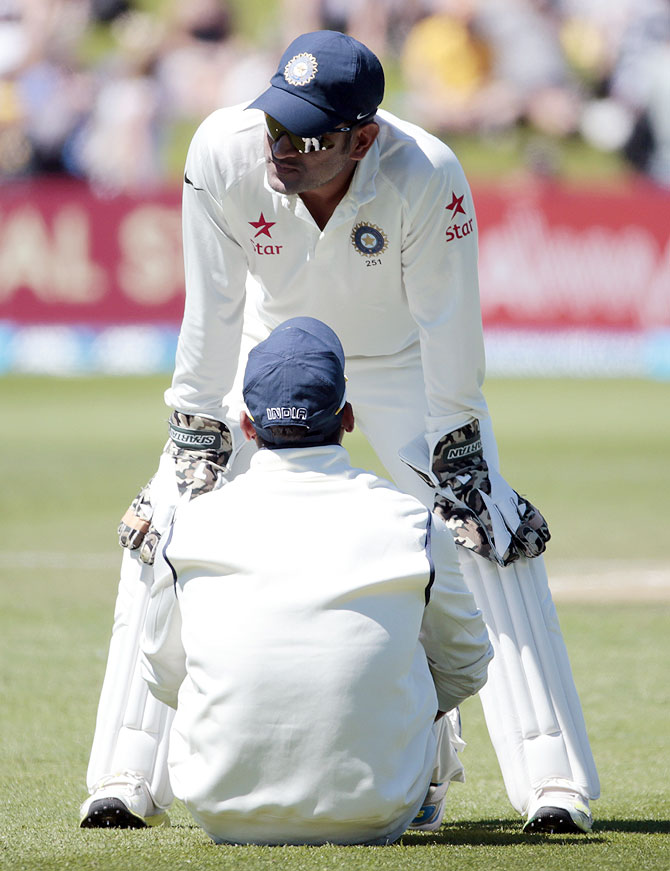 MS Dhoni talks to Murali Vijay (front) during the second Test on Sunday