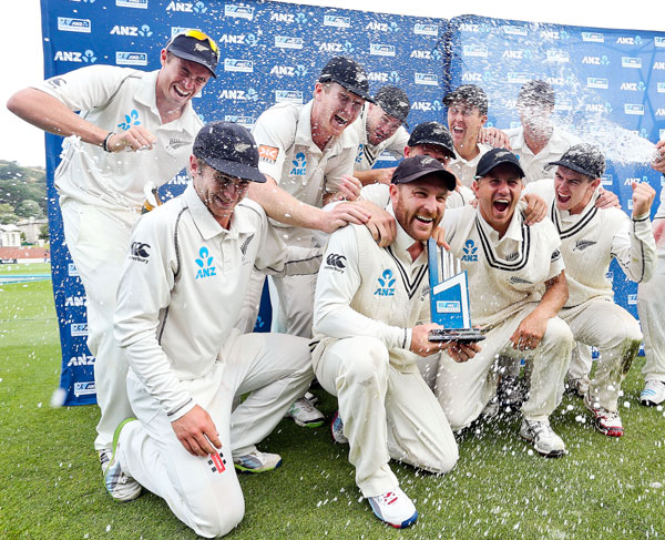 Man of the match Brendon McCullum celebrates the series triumph with teammates on Day 5 of the second Test against India in Wellington.