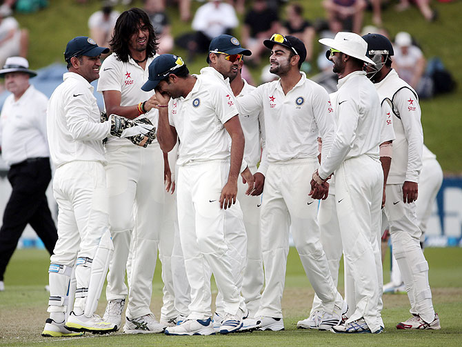 India's players celebrate a dismissal during the second Test against New Zealand