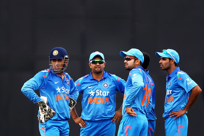 MS Dhoni, Suresh Raina, Virat Kohli and Bhuvneshwar Kumar look on