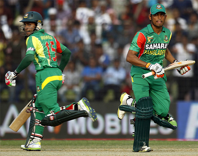 Bangladesh's Anamul Haque and captain Mushfiqur Rahim (left) run between the wickets