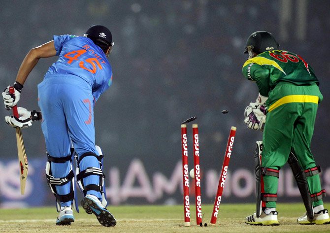 Bangladesh's wicketkeeper Anamul watches as Rohit Sharma is bowled