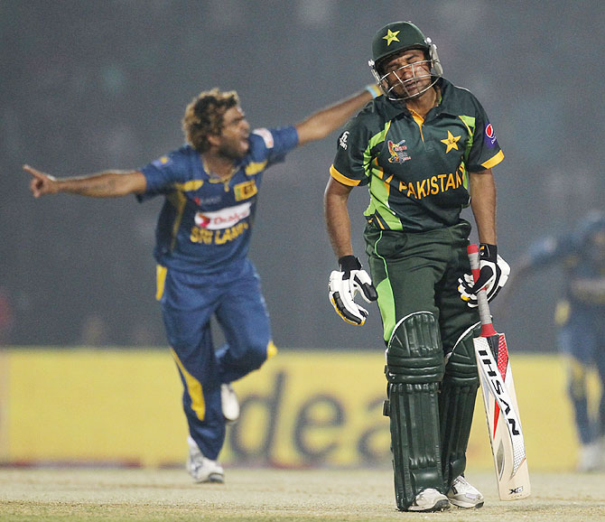 Pakistan's Bilawal Bhatti reacts as Sri Lanka's Lasith Malinga (left) celebrates his dismissal on Tuesday