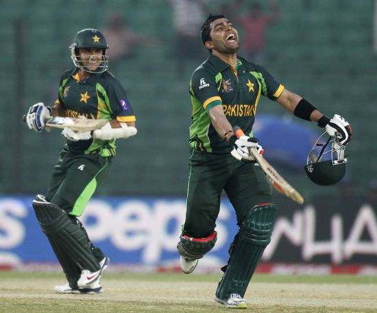 Umar Akmal celebrates after completing his century.