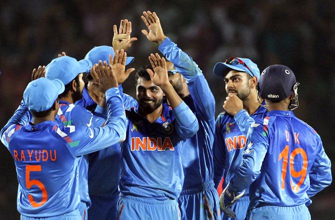 India's fielders celebrate the dismissal of Sri Lanka's Dinesh Chandimal