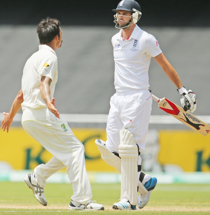 Mitchell Johnson of Australia celebrates after taking the wicket of James Anderson