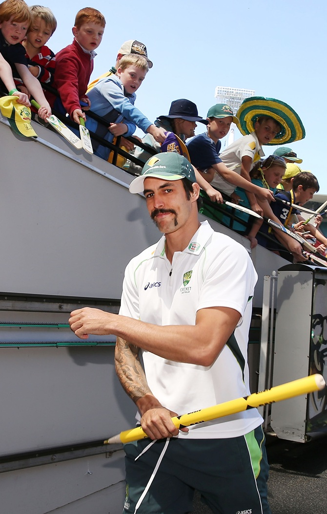 Mitchell Johnson of Australia walks to the change rooms with a stump after victory