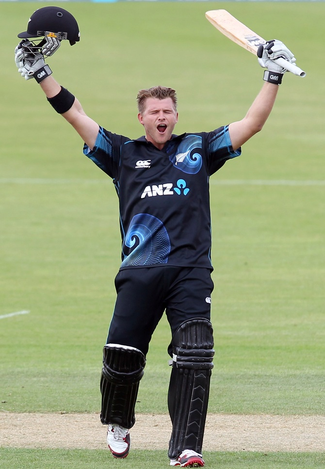 Corey Anderson of New Zealand celebrates scoring the fastest 100 runs