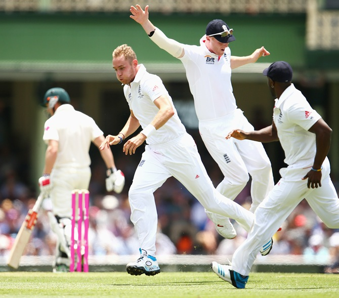Stuart Broad celebrates after taking the wicket of George Bailey