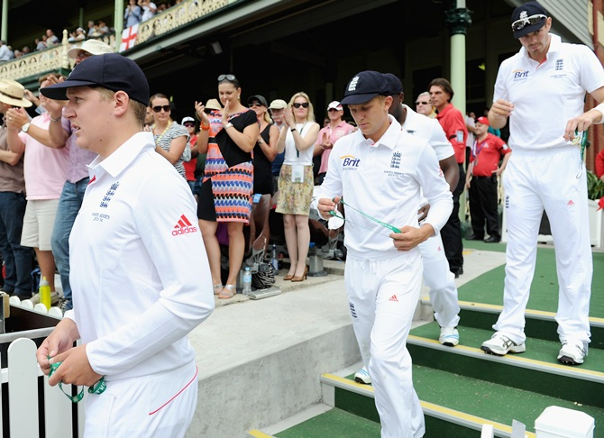Scott Borthwick and Boyd Rankin of England walk out on Day 1