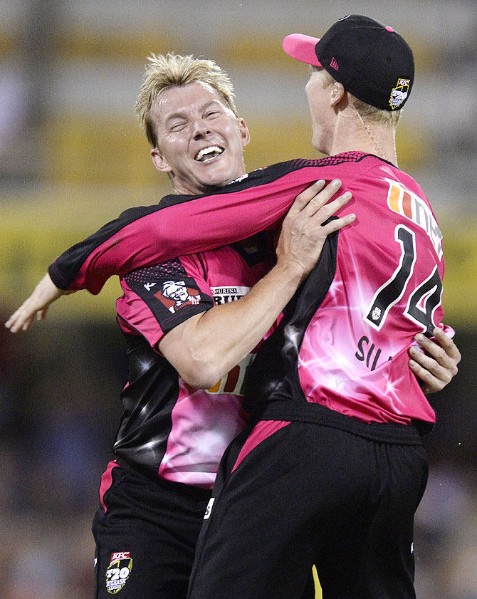 Brett Lee and Jordan Silk of the Sixers celebrate after Jordan Silk takes a spectacular catch to dismiss Craig Kieswetter of the Heat during the Big Bash League match between Brisbane Heat and the Sydney Sixers at The Gabba on Thursday