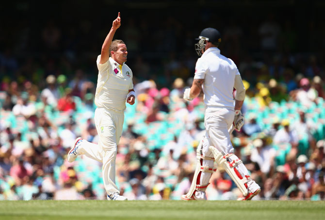 Peter Siddle of Australia celebrates after taking the wicket of Ben Stokes of England