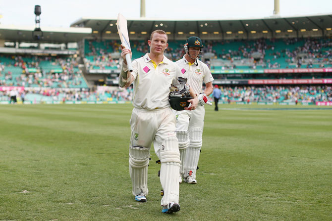 Chris Rogers of Australia acknowledges the crowd at the conclusion of play during day two
