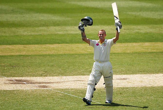 Chris Rogers of Australia celebrates scoring his century against England on Sunday